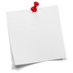 Weißer Merkzettel mit rotem Pin